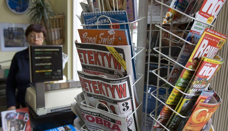 Schap met Poolse tijdschriften in een winkel speciaal voor werknemers uit Polen. © ANP Beeld