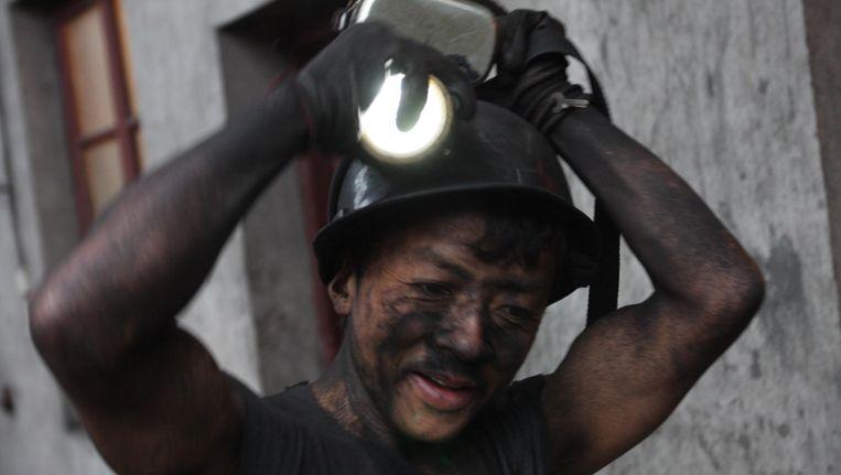 Een mijnwerker in China. Beeld AFP