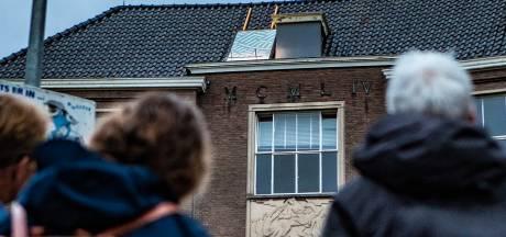 Raadsel in Deventer binnenstad: wat doet dat mannetje op het dak van het Hegius?