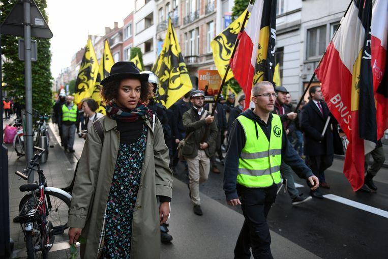 Naomi Camps was niet echt welkom bij de NSV-mars maar stapte dapper mee tot de politie ingreep om haar veiligheid te garanderen.