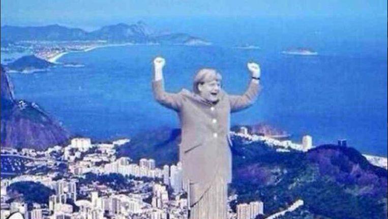 De beeltenis van de Duitse bondskanselier Angela Merkel op het beeld Christus de Verlosser in Rio de Janeiro. Beeld Twitter