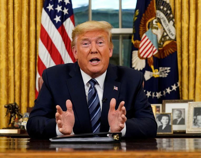 President Trump noemde het nieuwe coronavirus lange tijd een hype en weigerde lang om een noodplan uit te tekenen. Beeld