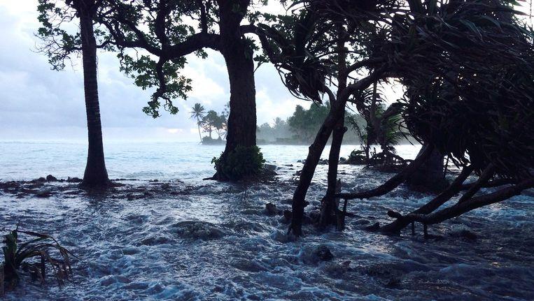 Overstroming op de Marshalleilanden in maart dit jaar, volgens de lokale overheid te wijten aan klimaatverandering. Beeld AFP