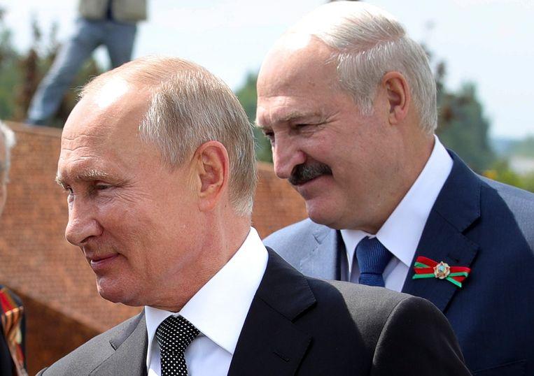Vladimir Poetin en de Belarussische president Aleksandr Loekasjenko Beeld AP