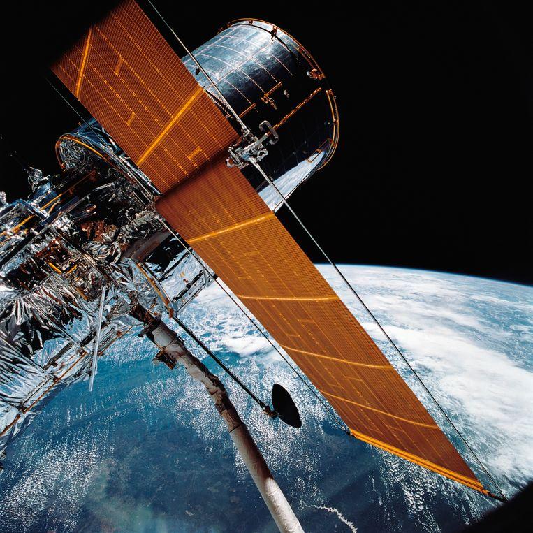 De ruimtetelescoop Hubble van Nasa, waarmee water in een atmosfeer van stikstof nog lastig te detecteren valt. Met de opvolger James Webb moet dat wel kunnen. Beeld AP