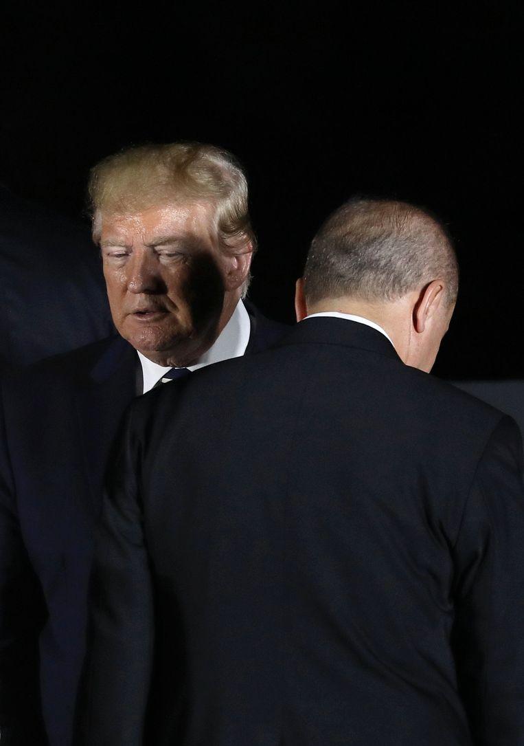 De Amerikaanse president Trump en zijn Turkse collega Erdogan tijdens de G20-top in Osaka, 28 juni 2019. Beeld AFP