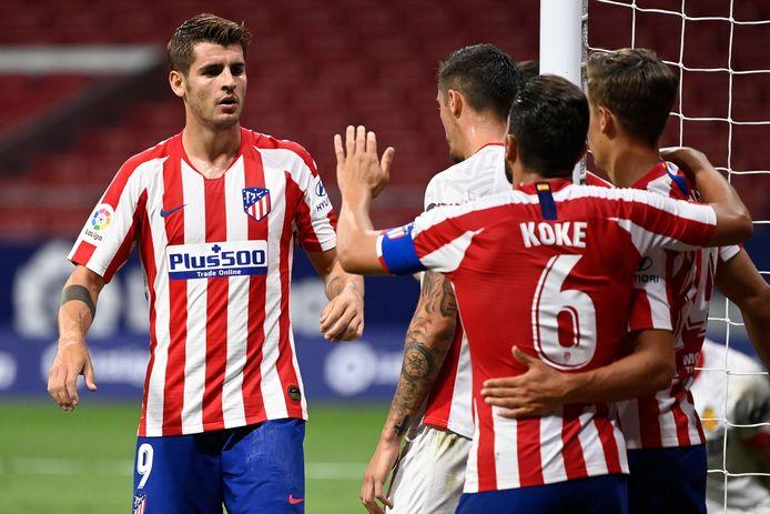 Alvaro Morata (links) viert zijn tweede goal met zijn ploeggenoten.