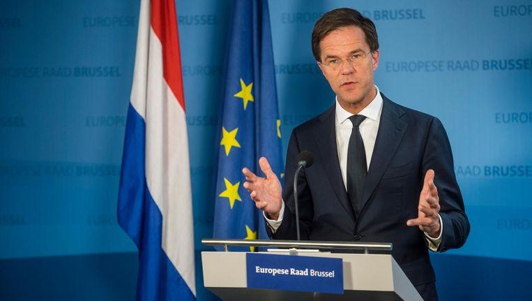 Premier Rutte tijdens een persconferentie vorig jaar december in Brussel, waar EU-landen spraken over het associatieverdrag met Oekraïne en het befaamde 'inlegvelletje' Beeld anp