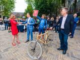 Bidbook per fiets naar Hilversum: Jaarbeurs niet hoog genoeg, Songfestival in tent van 18 meter hoog