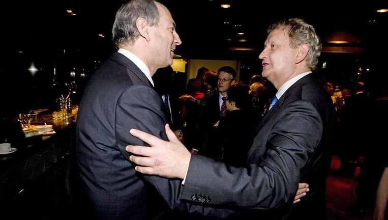 Eberhard van der Laan met zijn voorganger Job Cohen. Archieffoto ANP Beeld