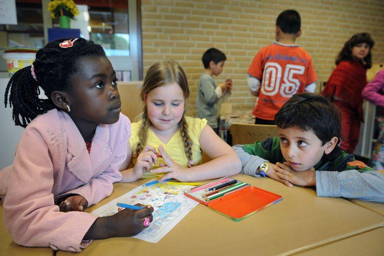 Kinderen op een basisschool. (Marcel van den Bergh / de Volkskrant) Beeld