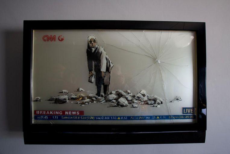 Het nieuwe werk van Banksy in Bethlehem is bovenal een protest tegen de Israëlische bezetting. Beeld null