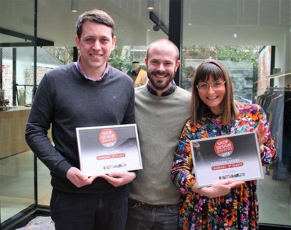 Jan D'Hollander van Jean., Laurent Temmerman van TOOP en Traces Jones van de gelijknamige damesboetiek zijn opgetogen met de bekroning als laureaat van de 'Shop Design Awards'.