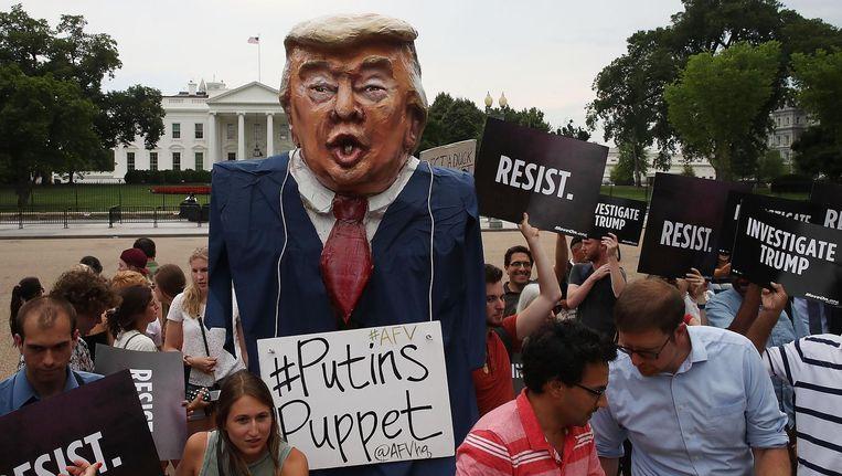 Demonstranten voor het Witte Huis in Washington. Beeld getty