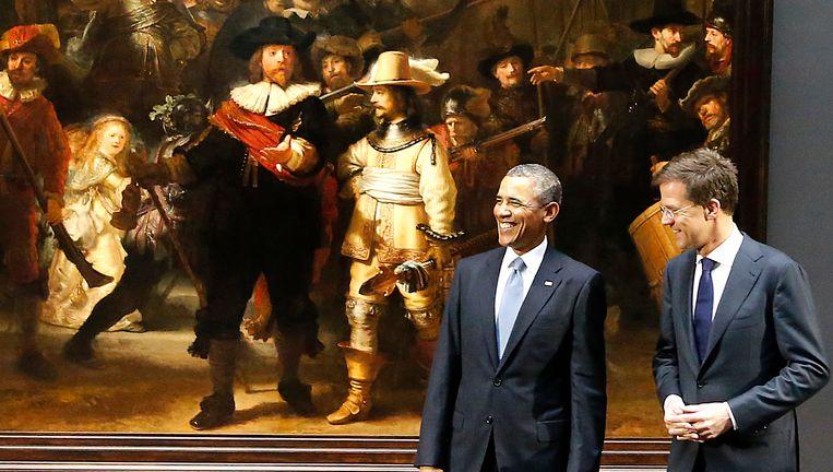 Memorabel moment van het afgelopen jaar: Barack Obama bezoekt het Rijksmuseum. Hier poseert hij met Mark Rutte voor de Nachtwacht. Beeld ap