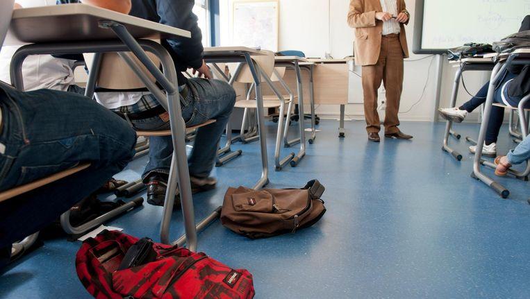 Zouden persoonlijke vorming en het aanleren van sociale vaardigheden minder goed gaan in klassen waar leerlingen van hetzelfde niveau bij elkaar zitten? Beeld Hollandse Hoogte