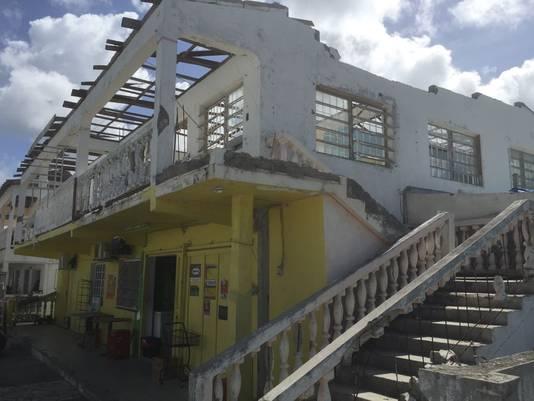 De huizen in de straat zijn na een jaar nog niet opgebouwd.