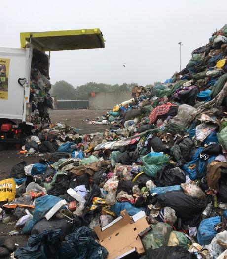 De weg van het afval, van je container aan de straat tot stoeptegels