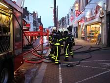 Afval in brand tussen twee panden in Molenstraat Roosendaal