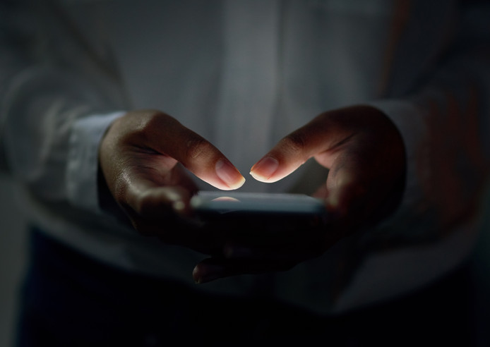 Cropped shot of an unrecognizable woman using a cellphone, Sexting