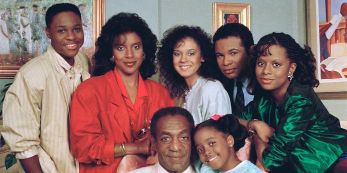 Owens (rechtsboven) tussen de cast van The Cosby Show.
