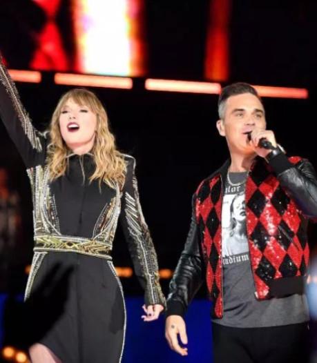 Taylor Swift verrast uitzinnige fans met Robbie Williams