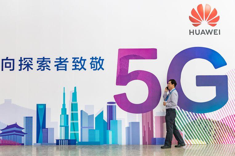Huawei-reclamebord op telecombeurs in Beijing, 2018. Beeld Getty