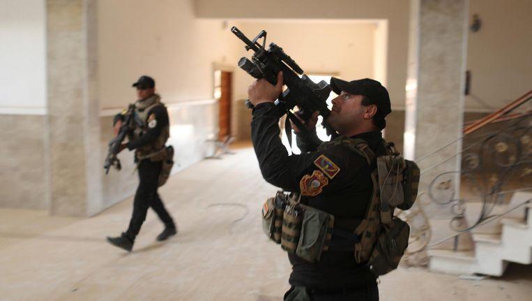 Leden van een speciale Iraakse eenheid bij Mosul. Beeld Reuters