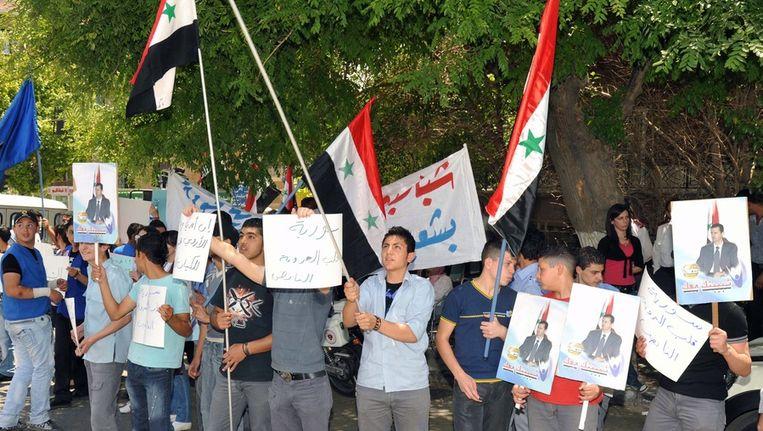 Een tegen de EU gericht protest gisteren in Damascus. Beeld null