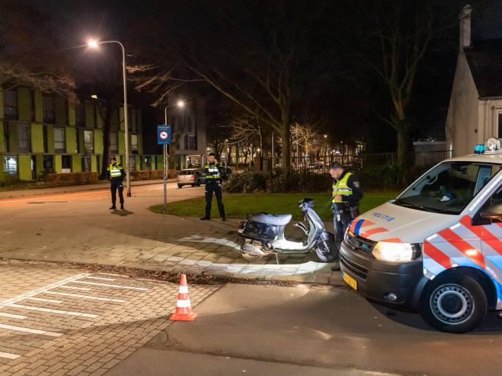 Automobilist vlucht na botsing met agent op scooter in Tilburg