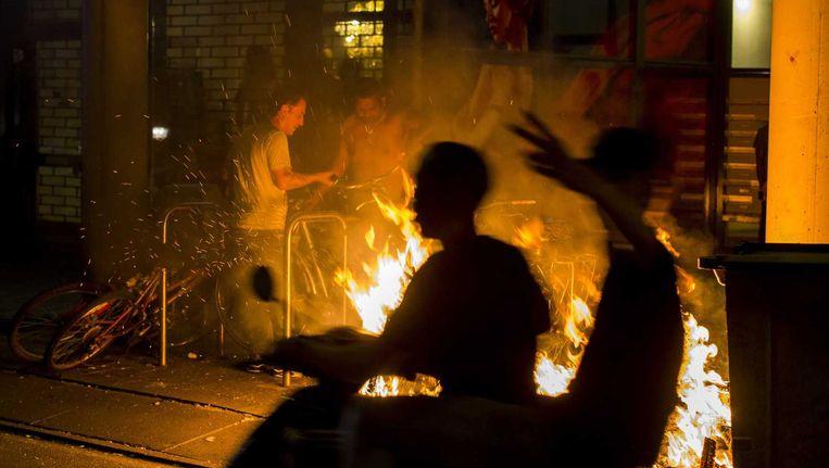 Rellen en brandstichting in de Schilderswijk Beeld anp