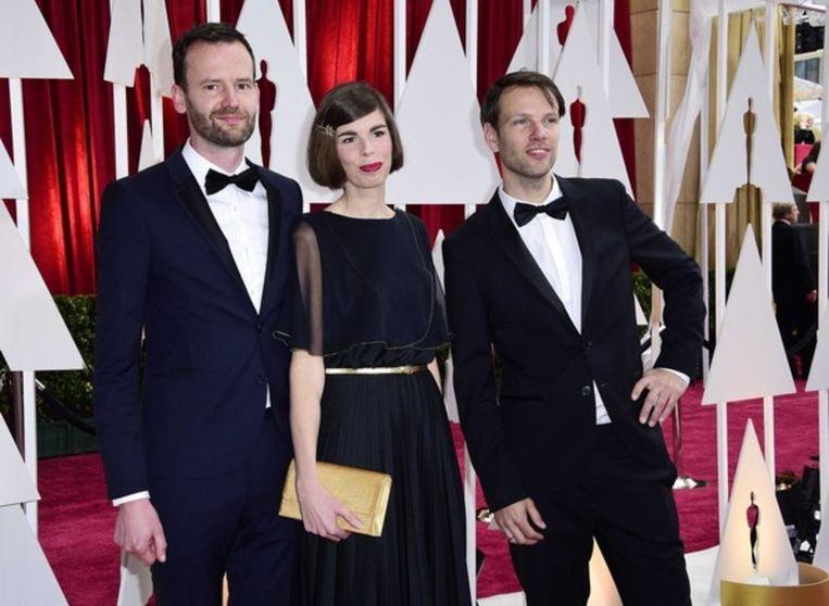 Joris Oprins, Marieke Blaauw en Job Roggeveen in 2015 op de rode loper bij de Oscars in Los Angeles. Beeld ANP