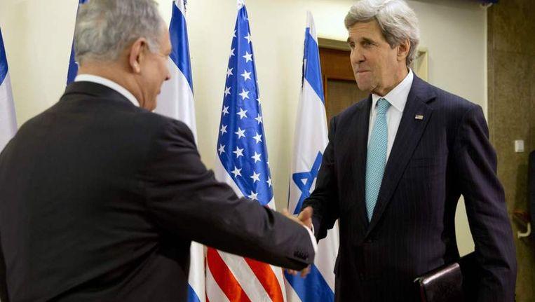 De Israëlische premier Netanyahu met John Kerry. Beeld reuters