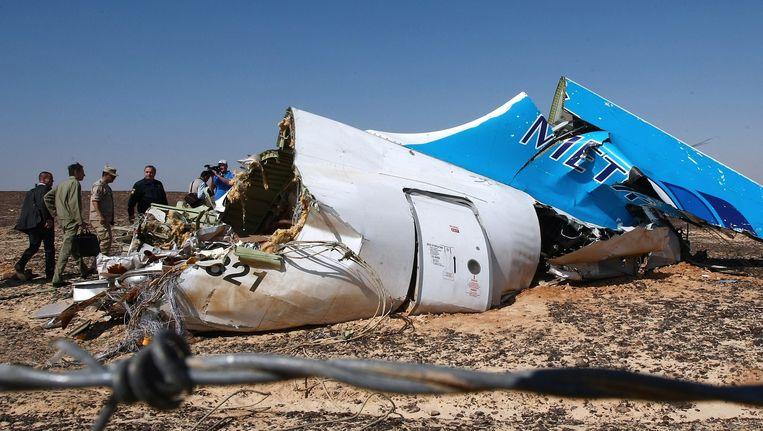 Het staartstuk van de neergestortte Airbus van Metrojet. Het toestel was gerepareerd nadat het in 2001 met de staart de grond raakte, een van de mogelijke oorzaken van de crash waarbij 224 mensen omkwamen, voornamelijk Russische toeristen. Beeld EPA