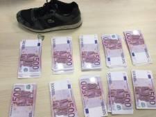 Sportschoenen vol cash: man met twee ton aangehouden op Eindhoven Airport