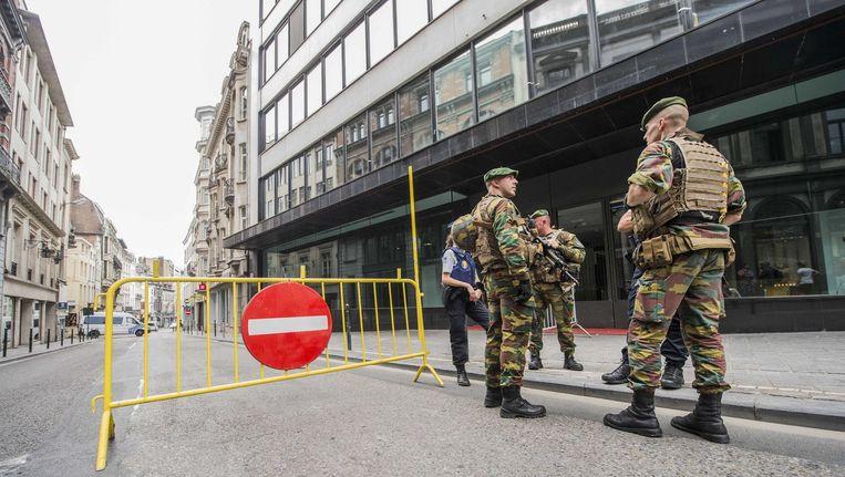 Zwaarbewapende militairen in Brussel. Beeld ANP