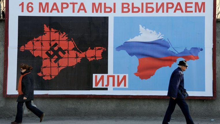 Verkiezingsposter in Sebastopol voor het Krim-referendum, 11 maart 2014. Beeld AFP
