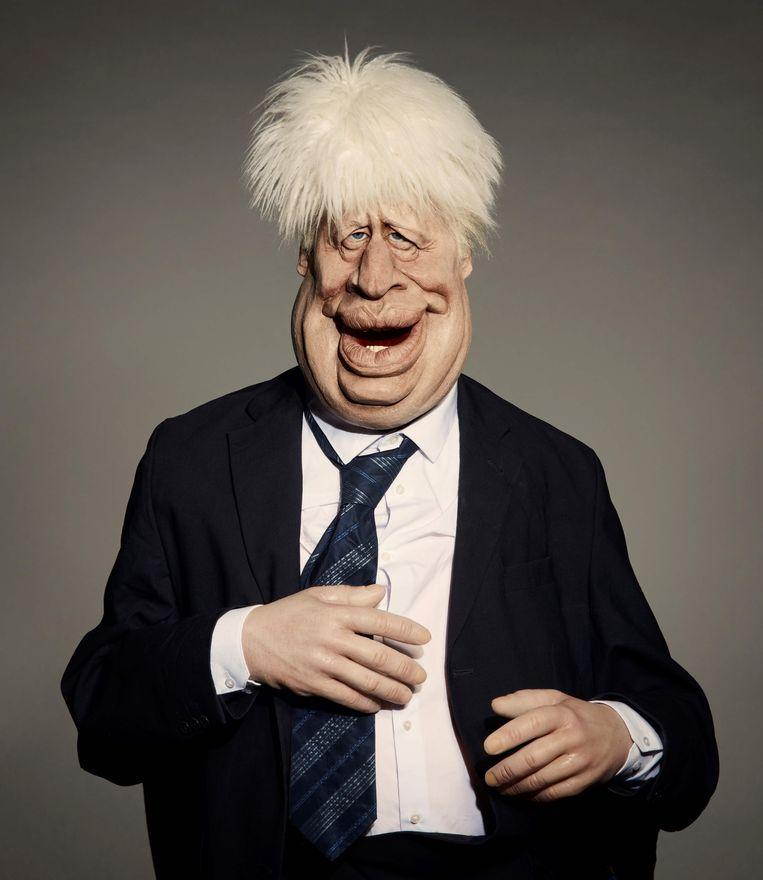Boris Johnson als handpop. Beeld AFP