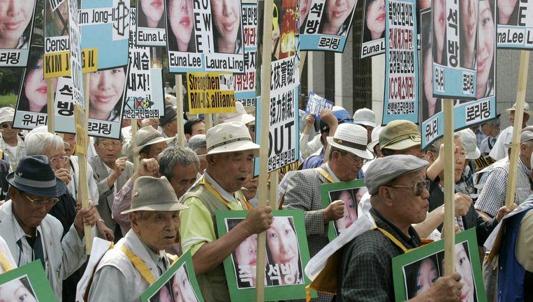 De straf voor de journalistes Euna Lee en Laura Ling is 'verpletterend', zeggen de families in een verklaring. Foto AP Beeld