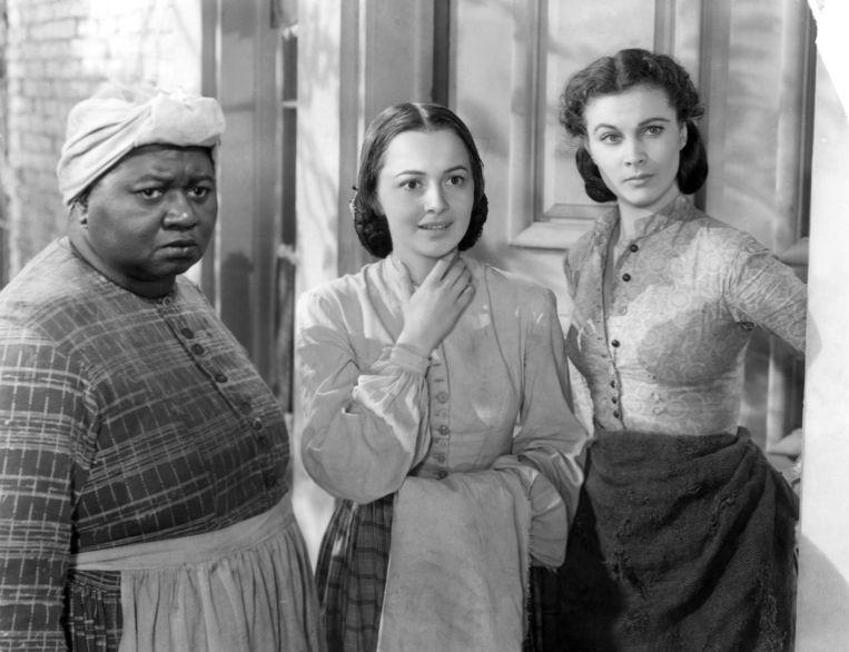 Van links naar rechts: Hattie McDaniel, Olivia de Havilland en Vivien Leigh in Gone with the Wind uit 1939. Beeld Warner Bros
