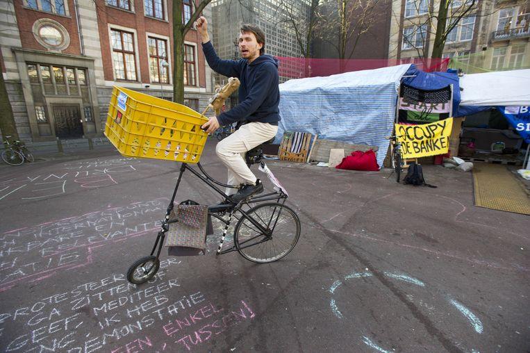 Occupy Amsterdam, vlak voordat ze moesten vertrekken van het Beursplein naar de Zuidas. Beeld anp