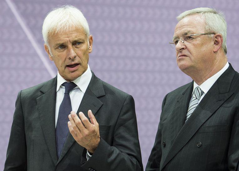Müller met voormalige Volkswagen-bestuurder Martin Winterkorn (R). Beeld afp