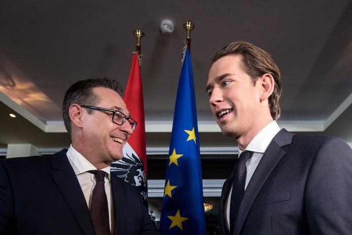 De nieuwe Oostenrijkse premier Sebastian Kurz (rechts) en zijn coalitiegenoot Heinz-Christian Strache van de extreemrechtse FPÖ.