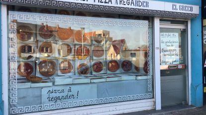 Etalage vol pizza's niet eetbaar