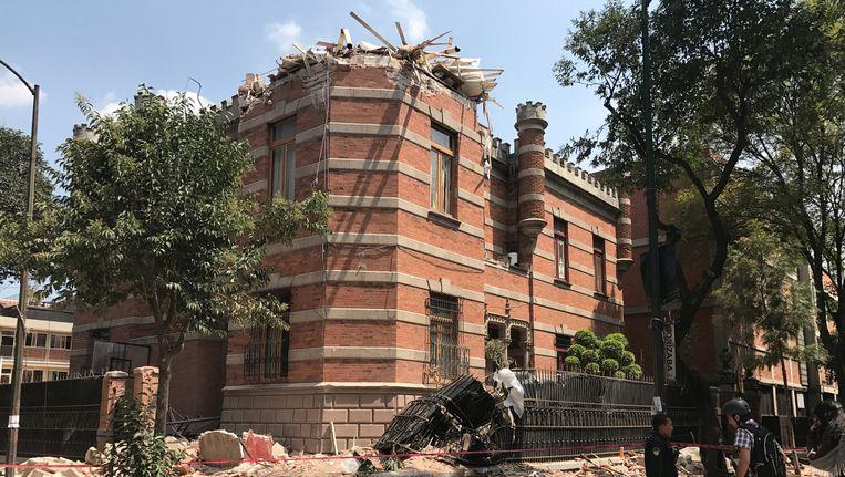 Schade aan een gebouw in Mexico-Stad. Beeld reuters