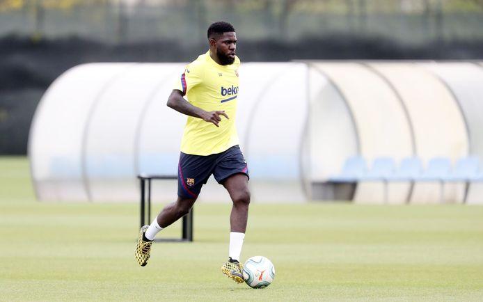 Samuel Umtiti in actie tijdens de training.