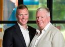 Vader en zoon Erwin (links) en André Kwakernaat werken samen bij Wolters Kluwer Tax & Accounting.