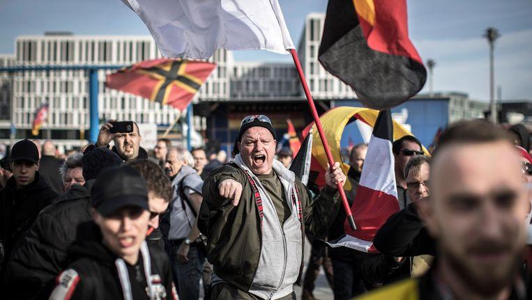 Extreemrechtse demonstratie in Berlijn, bijgewoond door neonazi's en sympathisanten van de Duitse politieke partij NPD, op 4 maart 2017. Beeld null