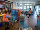 Geen gehannes meer met spray in AH Elst om winkelwagen virusvrij te krijgen