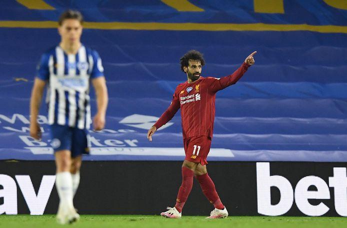 Salah viert een doelpunt.